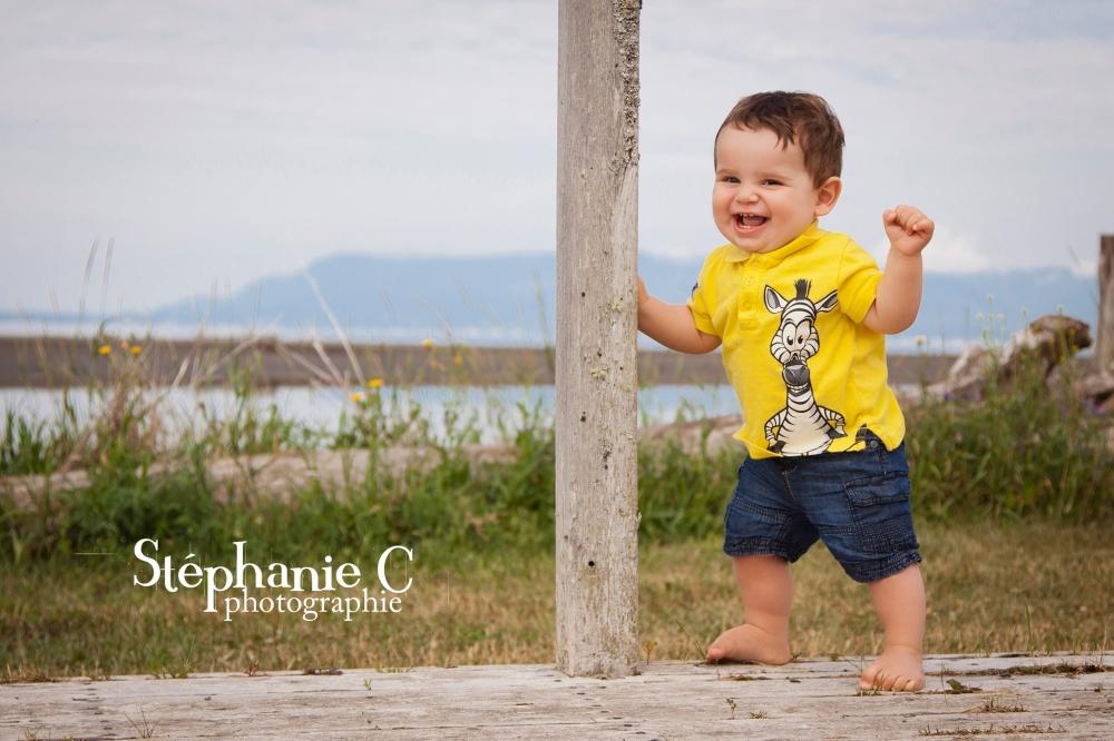 bébé Emerick a la plage 1 an